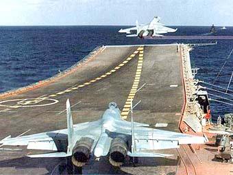 www.FEA.ru_Су-33 взлетает с палубы ТАНКР