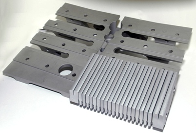 CompMechLab/ Фрагмент вольфрамовой облицовки дивертора термоядерного реактора JET, установленной на держатель